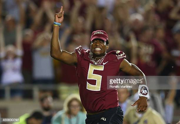 Jameis Winston of the Florida State Seminoles runs on the field to celebrate the overtime win against the Clemson Tigers at Doak Campbell Stadium on...