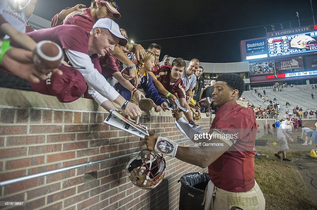 Jameis Winston of the Florida State Seminoles signs autographs after ther game against of the Idaho Vandals at Doak Campbell Stadium on November 23...