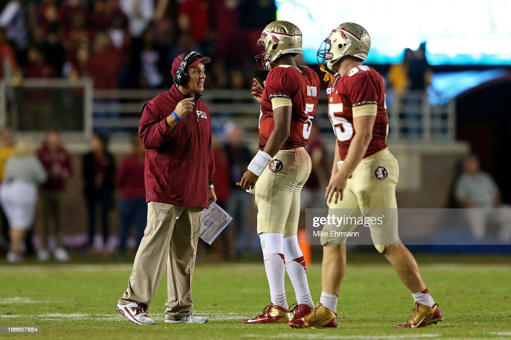 Jameis Winston #5 of the Florida State Seminoles talks with head coach Jimbo Fisher during a game against the Miami Hurricanes at Doak Campbell Stadium on November 2, 2013 in Tallahassee, Florida.