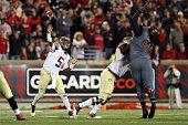 Jameis Winston of the Florida State Seminoles throws a pass in the second quarter against the Louisville Cardinals during their game at Papa John's...