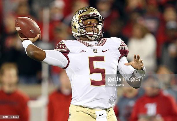 Jameis Winston of the Florida State Seminoles throws a pass in the fourth quarter against the Louisville Cardinals during their game at Papa John's...