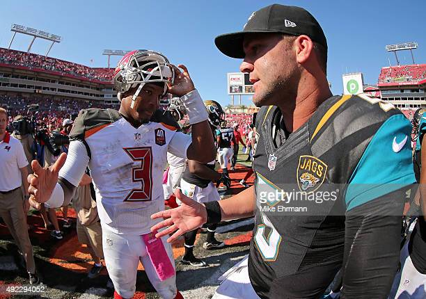 Jameis Winston of the Tampa Bay Buccaneers and Blake Bortles of the Jacksonville Jaguars shake hands following a game at Raymond James Stadium on...