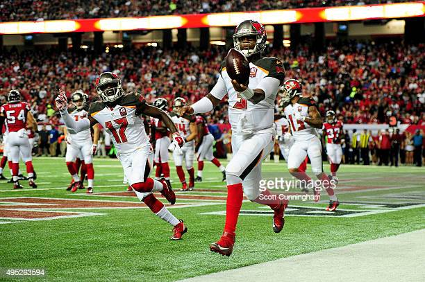 Jameis Winston of the Tampa Bay Buccaneers celebrates a rushing touchdown during the second half against the Atlanta Falcons at the Georgia Dome on...