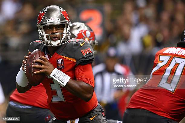 Jameis Winston of the Tampa Bay Buccaneers drops back to pass during the third quarter of a game against the New Orleans Saints at the MercedesBenz...