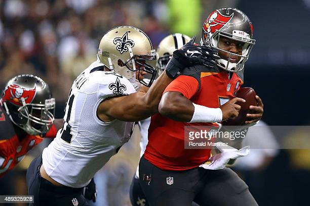 Jameis Winston of the Tampa Bay Buccaneers is pursued by Kasim Edebali of the New Orleans Saints during the first quarter of a game at the...