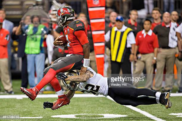 Jameis Winston of the Tampa Bay Buccaneers is tackled by Kenny Vaccaro of the New Orleans Saints at MercedesBenz Superdome on September 20 2015 in...