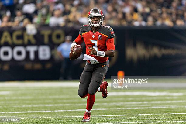 Jameis Winston of the Tampa Bay Buccaneers rolls out looking for a receiver during a game against the New Orleans Saints at MercedesBenz Superdome on...