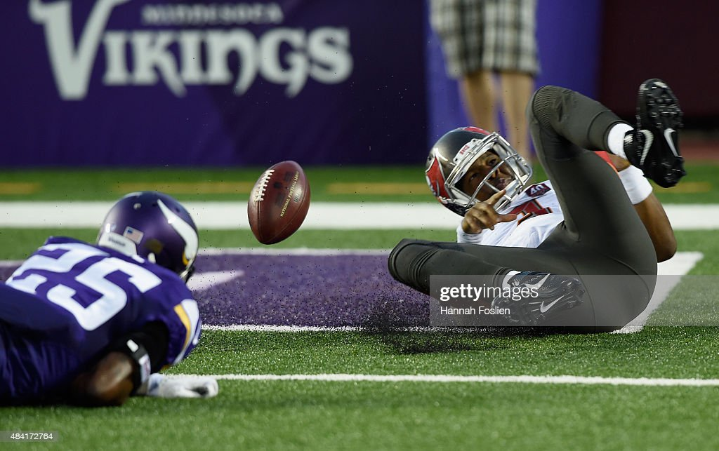 Jameis Winston #3 of the Tampa Bay Buccaneers scores a touchdown adjacent Jabari Price #25 of the Minnesota Vikings during the second quarter of the preseason game on August 15, 2015 at TCF Bank Stadium in Minneapolis, Minnesota.