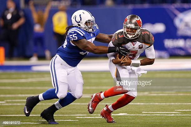 Jameis Winston of the Tampa Bay Buccaneers tries to escape from Nate Irving of the Indianapolis Colts in the fourth quarter of the game at Lucas Oil...