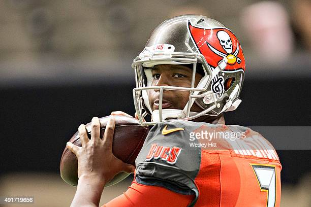 Jameis Winston of the Tampa Bay Buccaneers warming up before a game against the New Orleans Saints at MercedesBenz Superdome on September 20 2015 in...