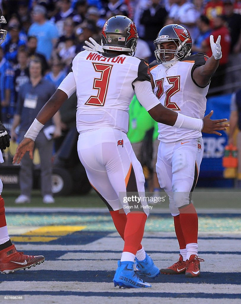 Jameis Winston #3 reacts with Doug Martin #22 of the Tampa Bay Buccaneers afrer scoring against the San Diego Chargers during the first half of a game at Qualcomm Stadium on December 4, 2016 in San Diego, California.