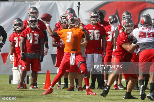 Jameis Winston wearing a brace sets up to throw down field during the Tampa Bay Buccaneers Training Camp on July 29 2017 at One Buccaneer Place in...