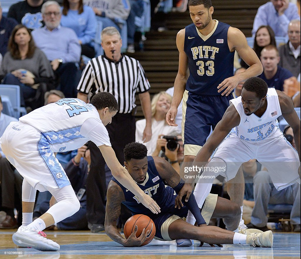 Jamel Artis #1 of the Pittsburgh Panthers battles <a gi-track='captionPersonalityLinkClicked' href=/galleries/search?phrase=Justin+Jackson+-+Basketballspieler+-+Angreifer+-+geb.+1995&family=editorial&specificpeople=12699010 ng-click='$event.stopPropagation()'>Justin Jackson</a> #44 and <a gi-track='captionPersonalityLinkClicked' href=/galleries/search?phrase=Theo+Pinson&family=editorial&specificpeople=8025016 ng-click='$event.stopPropagation()'>Theo Pinson</a> #1 of the North Carolina Tar Heels for a loose ball during their game at the Dean Smith Center on February 14, 2016 in Chapel Hill, North Carolina. North Carolina won 85-64.