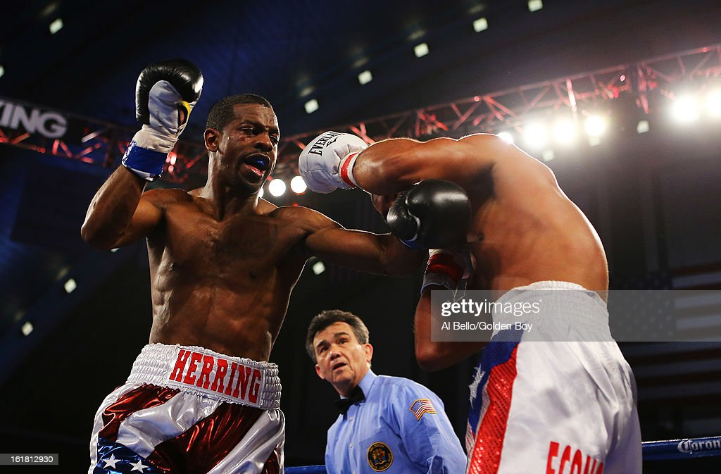 Jamel Herring punches Carlos Lopez during their Junior Lightweight fight at Atlantic City Boardwalk Hall on February 16, 2013 in Atlantic City, New Jersey.