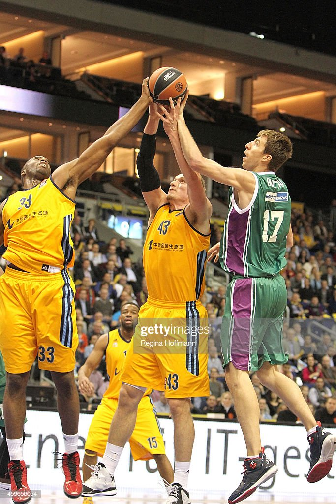 Jamel McLean, #33 of Alba Berlin, Leon Radosevic, #43 of Alba Berlin and <a gi-track='captionPersonalityLinkClicked' href=/galleries/search?phrase=Fran+Vazquez&family=editorial&specificpeople=2236558 ng-click='$event.stopPropagation()'>Fran Vazquez</a>, #17 of Unicaja Malaga in action during the 2014-2015 Turkish Airlines Euroleague Basketball Regular Season Date 7 game between Alba Berlin v Unicaja Malaga at O2 World on November 27, 2014 in Berlin, Germany.