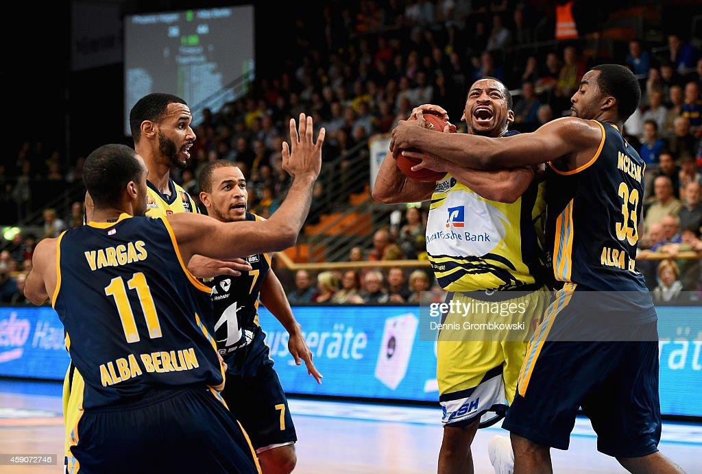 Jamel McLean of ALBA Berlin challenges David Bell of Phoenix Hagen during the Beko BBL Basketball Bundesliga match between Phoenix Hagen and ALBA...