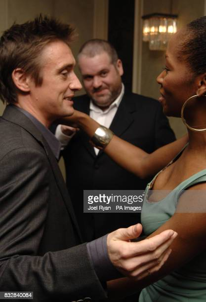 Jamelia congratulates Richard Hammond upon winning the award for Satellite/Digital TV Personality as DJ Chris Moyles looks on at the TRIC 2007 Annual...