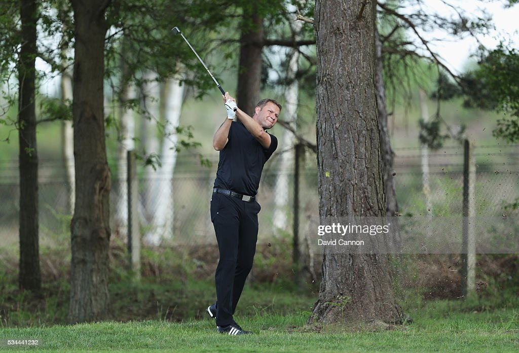 James Ablett of England hits his 2nd shot on the 9th hole during day one of the BMW PGA Championship at Wentworth on May 26, 2016 in Virginia Water, England.