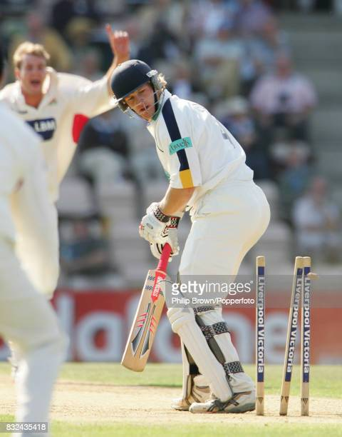 James Adams of Hampshire is bowled by Tom Smith of Lancashire for 32 runs during the County Championship match between Hampshire and Lancashire at...