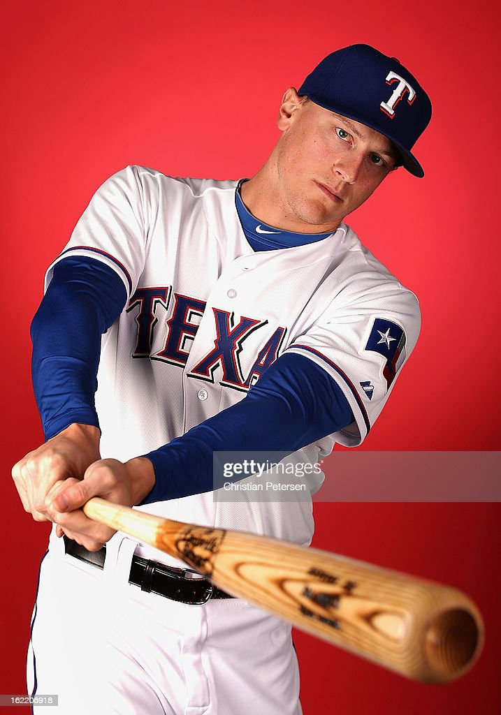 James Adduci #71 of the Texas Rangers poses for a portrait during spring training photo day at Surprise Stadium on February 20, 2013 in Surprise, Arizona.