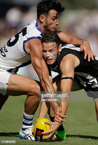 James Aish of the Magpies and Robbie Tarrant of the Kangaroos compete for the ball during the 2016 AFL NAB Challenge match between the North...