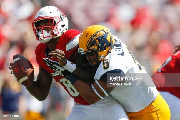 James Alexander of the Kent State Golden Flashes sacks Lamar Jackson of the Louisville Cardinals during the second half at Papa John's Cardinal...