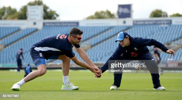 James Anderson and Joe Root of England take part in a fielding drill during a nets session at Headingley on August 23 2017 in Leeds England