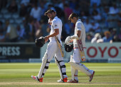 James Anderson and Mark Wood of England head back to the pavillion after the fall of the last wicket during day four of the 2nd Investec Ashes Test...