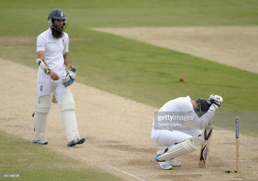 James Anderson and Moeen Ali of England react after losing the 2nd Investec Test match between England and Sri Lanka at Headingley Cricket Ground on June 24, 2014 in Leeds, England.
