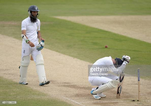 James Anderson and Moeen Ali of England react after losing the 2nd Investec Test match between England and Sri Lanka at Headingley Cricket Ground on...