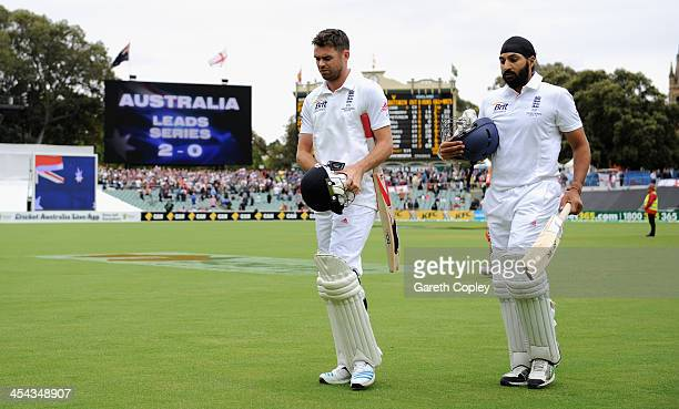 James Anderson and Monty Panesar of England leave the field after losing the Second Ashes Test Match between Australia and England at Adelaide Oval...