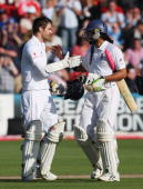 James Anderson and Monty Panesar of England shake hands after securing the draw during day five of the npower 1st Ashes Test Match between England...