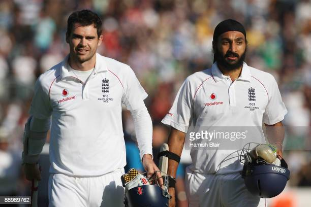 James Anderson and Monty Panesar of England walk off after securing the draw during day five of the npower 1st Ashes Test Match between England and...