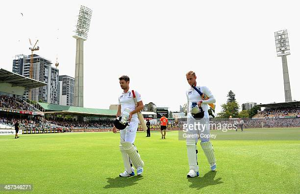 James Anderson and Stuart Broad of England leaves the field after losing the Third Ashes Test Match between Australia and England at WACA on December...