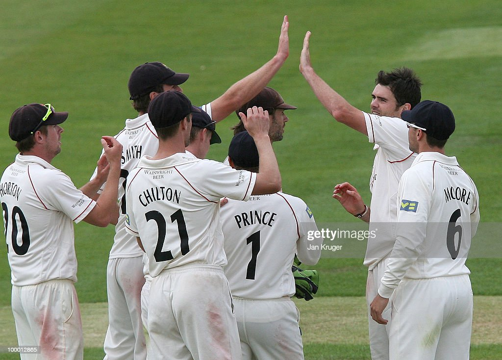 James Anderson (2ndR) celebrates a wicket with team mates during the LV County Championship Division One match between Warwickshire and Lancashire at Edgbaston on May 20, 2010 in Birmingham, England.