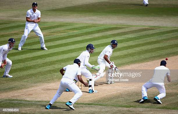 James Anderson of dives to take the catch of Bhuvneshwar Kumar of off the bowling of Moeen Ali during day five of the 3rd Investec Test match between...