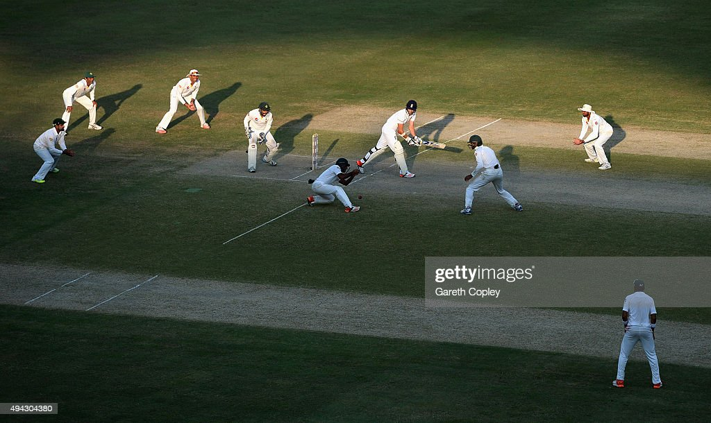James Anderson of England bats surrounded by Pakistan fielders during day five of the 2nd test match between Pakistan and England at Dubai Cricket Stadium on October 25, 2015 in Dubai, United Arab Emirates.