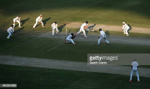 James Anderson of England bats surrounded by Pakistan fielders during day five of the 2nd test match between Pakistan and England at Dubai Cricket...