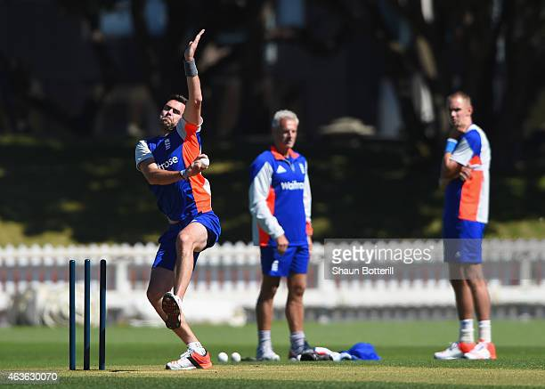 James Anderson of England bowls as coach Peter Moores and Stuart Broad look on during an England nets session at Basin Reserve on February 17 2015 in...