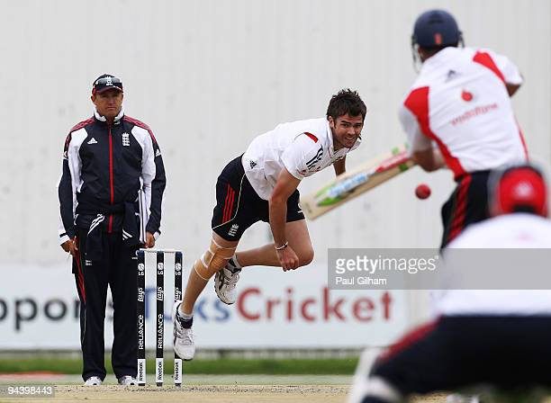 James Anderson of England bowls as England Coach Andy Flower looks on during an England Nets Session at the High Performance Centre at the University...