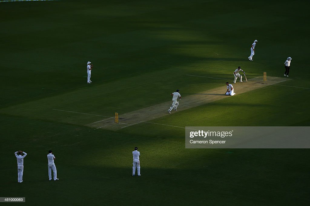 James Anderson of England bowls to Ryan Harris of Australia during day one of the First Ashes Test match between Australia and England at The Gabba on November 21, 2013 in Brisbane, Australia.