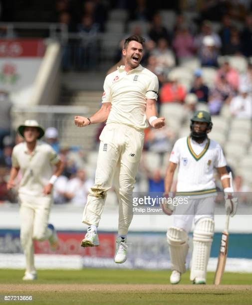 James Anderson of England celebrates after dismissing Heino Kuhn of South Africa during the fourth day of the 4th Investec Test match between England...