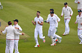 James Anderson of England celebrates after dismissing New Zealand batsman Martin Guptill to claim his 400th test match wicket as catcher Ian Bell is...