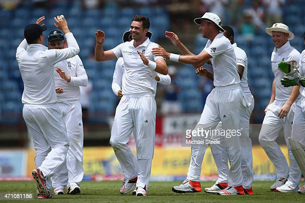 James Anderson of England celebrates alongside Stuart Broad and Gary Ballance after running out Jason Holderof West Indies during day five of the 2nd...