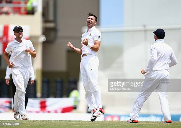 James Anderson of England celebrates claiming the wicket of Marlon Samuels of West Indies to equal Ian Botham's record of 383 Test wickets during day...