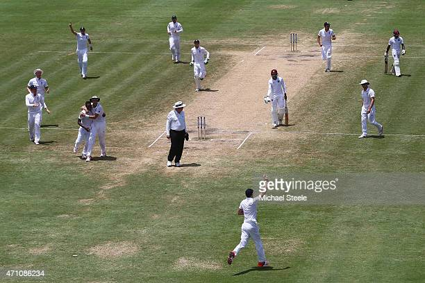 James Anderson of England celebrates taking the catch off the bowling of Chris Jordan to dismiss Jermaine Blackwood of West Indies during day five of...