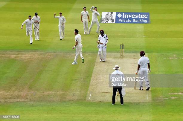 James Anderson of England celebrates taking the wicket of Kraigg Braithwaite of the West Indies during day one of the 3rd Investec Test Match between...