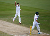 James Anderson of England celebrates taking the wicket of Stephen Cook of South Africa caught behind during day four of the 4th Test at Supersport...
