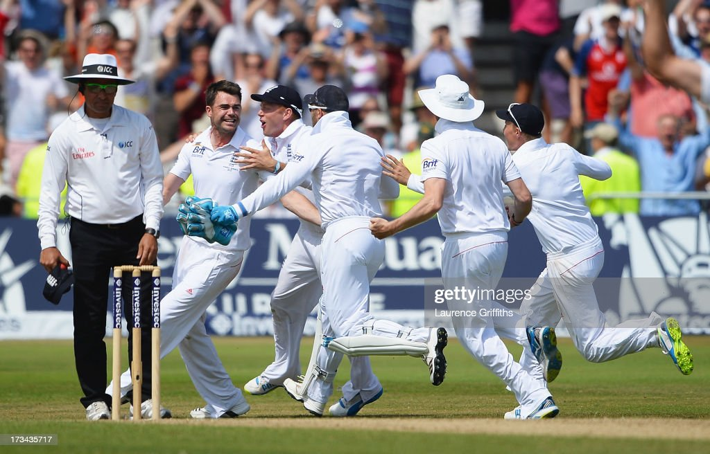 James Anderson of England celebrates the final wicket of Brad Haddin of Australia and victory with team mates during day five of the 1st Investec Ashes Test match between England and Australia at Trent Bridge Cricket Ground on July 14, 2013 in Nottingham, England.