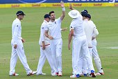 James Anderson of England celebrates the wicket of Dean Elgar of the Proteas with his team mates during day 3 of the 4th Test match between South...